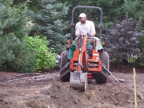 Employee of PBOG on a small excavator
